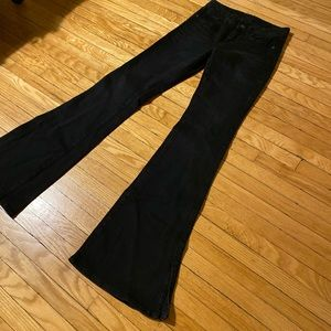 Black 70s-style skinny jean with flare